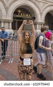 WASHINGTON, DC, USA - APRIL 29, 2017: Climate March demonstrator, at Trump International Hotel on Pennsyvania Avenue.