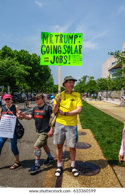 WASHINGTON, DC, USA - April 29, 2017.  Protesters holding signs at the People's Climate Change March. The march started at the U.S. Capitol and proceeded up Pennsylvania Avenue to the White House.