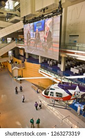 WASHINGTON, DC, USA - APRIL 30, 2008: Newseum, an interactive museum of journalism and news. Interior with news helicopter, big screen and visitors.