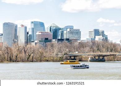 Washington DC, USA - April 5, 2018: Tour boats, tourboats on Potomac river with view on northern Virginia, Boomerang Yacht cruise toar boat on Potomac river with skyline of Arlington, Virginia