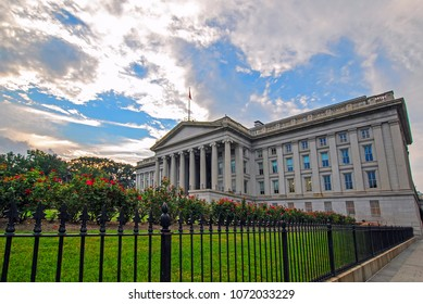 Washington, DC, USA - August 04, 2012: The Treasury Department Federal Credit Union Building with green grass and beautiful flowers in front of it, Pennsylvania Avenue Northwest
