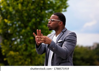 Washington, DC, USA - August 1, 2020: American Sign Language interpreter Billy Sanders on stage at the Demand DC rally at the National Museum of African American History and Culture
