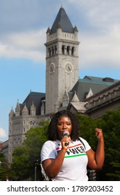 Washington, DC, USA - August 1, 2020: A Dreamer (DACA) student speaks to the crowd at Freedom Plaza during the Demand DC protest, with the Trump Hotel in the background