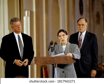 Washington DC. USA, August 10, 1993 President William Jefferson Clinton listens to newly sworn Associate Justice Ruth Bader Ginsberg as she addresses members of the White House press in the East Room
