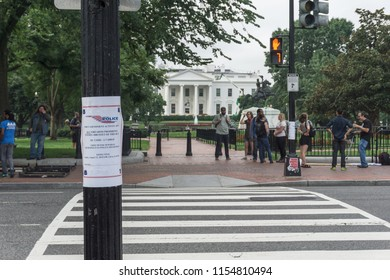 Washington, DC / USA - August 12, 2018: as Unite the Right counter-protesters prepare near the White House, a sign prohibiting firearms is taped to a light pole.