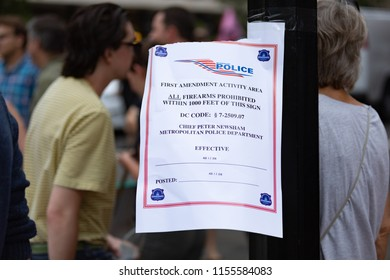 """Washington D.C. / USA — August 12, 2018: Metropolitan Police """"First Amendment Activity Area"""" posted sign during Unite the Right rally in Washington D.C. Editorial Use Only."""