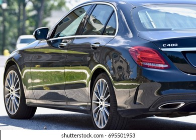 WASHINGTON DC, USA - AUGUST 13, 2017: A black Mercedes-Benz C-400 parked on the street.