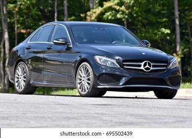 WASHINGTON DC, USA - AUGUST 13, 2017: A black Mercedes Benz C-400 parked on the street.
