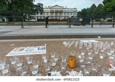 WASHINGTON, DC, USA - AUGUST 14, 2017: A candlelight memorial to Heather Heyer, and against neo-Nazis, is in front of the White House.