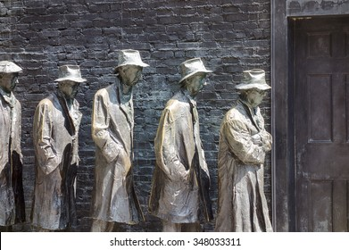 WASHINGTON DC, USA - AUGUST 20, 2014: An art installation at the Franklin Delano Roosevelt Memorial in Washington DC shows a bread line of five men to commemorate the Great Depression of the 1930s.