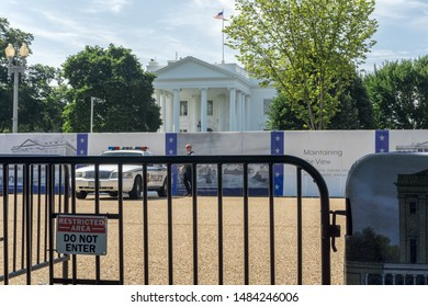 Washington, DC / USA - August 21, 2019: Secret Service today closed Pennsylvania Avenue in front of the White House while the old White House fence is replaced with a taller and more secure fence.