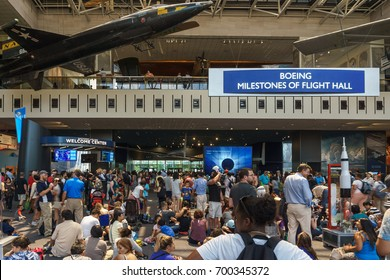 WASHINGTON, DC, USA - AUGUST 21, 2017: Crowds gather at the Smithsonian National Air & Space Museum on the Mall to watch the 2017 Solar Eclipse.