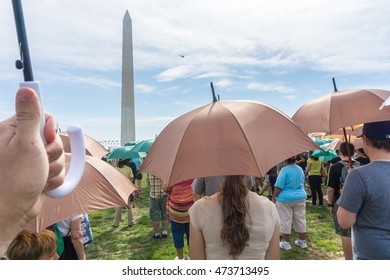 WASHINGTON, DC, USA - AUGUST 25, 2016: For the National Park Service's 100th Anniversary, over 1000 people gathered at the base of the Washington Monument to make a human National Park Service emblem.