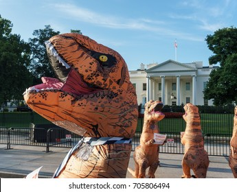 WASHINGTON, DC, USA - AUGUST 30, 2017: Service Year DC protests with T-Rex costumes in front of the White House to help keep AmeriCorps and the Peace Corps from going extinct.