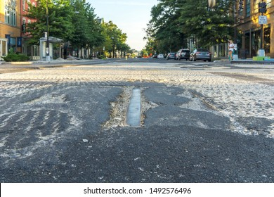 Washington, DC /USA - August 31, 2019: As renovations continue on 14th St NW, old streetcar tracks, which have been paved over for several decades, have been exposed.
