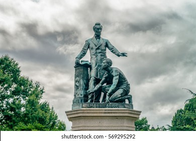 WASHINGTON DC, USA - AUGUST 5, 2016: Freedman's Memorial is a monument in Lincoln Park. The bronze statue features President Lincoln standing with his left arm out-stretched over a freed slave.