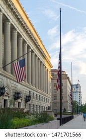 Washington, DC / USA - August 6, 2019: flags fly at half-staff throughout Washington after the shootings in Dayton and El Paso.