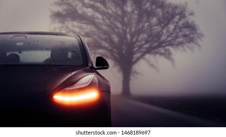 Washington DC, Washington / USA - August 7th 2019 : Photograph of a Tesla model 3 in the fog.