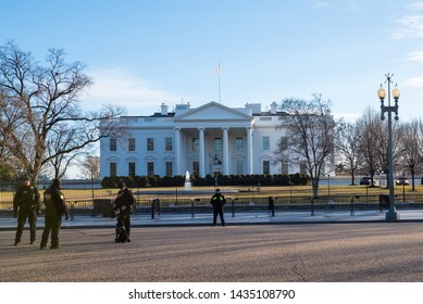 Washington, DC / USA - Circa February 2018: A Group Of Secret Service Agents Seen At The Outside Boundary Of The White House During A Winter Day