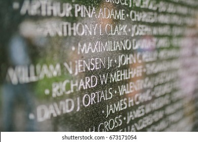 WASHINGTON D.C., USA - CIRCA MAY 2017: Names of fallen U.S. service members from the Vietnam War engraved on the wall of the Vietnam Veterans Memorial in Washington, D.C.