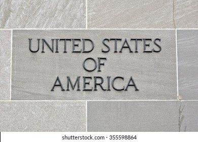 WASHINGTON DC, USA - DECEMBER 27, 2015: Stone wall with United States of America embedded into it at the National Mall. The National Mall is a national park in downtown Washington, D.C.