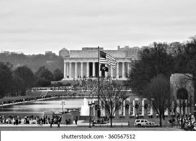WASHINGTON DC, USA - DECEMBER 27, 2015: Tourists explore the National Mall. The National Mall is a national park in downtown Washington, D.C.