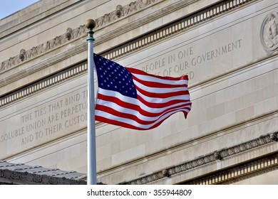 WASHINGTON DC, USA - DECEMBER 28, 2015: American flag in front of a historic building at the National Mall. The National Mall is a national park in downtown Washington, D.C.