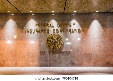 Washington DC, USA - December 28, 2017: FDIC United States Federal Deposit Insurance Corporation sign on wall of building with logo on 17th street in evening night closeup