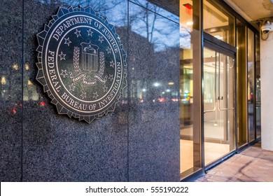 Washington DC, USA - December 29, 2016: FBI, Federal Bureau of Investigation Headquarters, on Pennsylvania avenue sign with traffic reflections at night