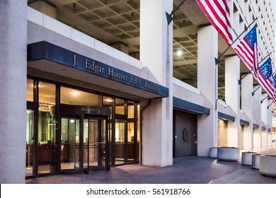 Washington DC, USA - December 29, 2016: FBI, Federal Bureau of Investigation Headquarters, on Pennsylvania avenue sign with American flags