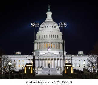 Washington, DC / USA - December 3, 2018: the United States Capitol is lit up and open all night for visitors to pay their respects to President George H.W. Bush, who is lying in State in the Capitol.
