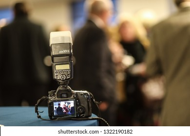 Washington, D.C. / USA - December 3, 2018: An event photographer leaves a Canon 5D Mark IV on a standing table at free networking event for business professionals in the city.