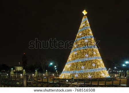 WASHINGTON, DC, USA - DECEMBER 4, 2017: The National Christmas Tree is lit behind the White House.