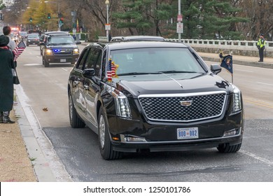 Washington, DC / USA - December 5, 2018: Preident Trump drives in thenew Presidential Limo, the Beast, to the State Funeral of President George H.W. Bush.