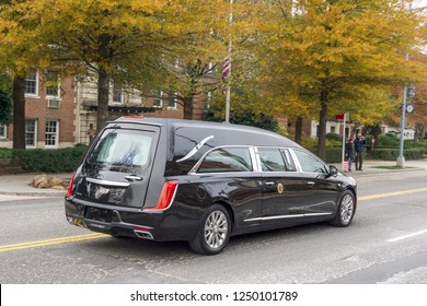Washington, DC / USA - December 5, 2018: The hearse carrying the casket of President George H.W. Bush drives to the State Funeral at Washington National Cathedral.