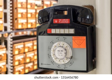 Washington, DC / USA - February 18, 2019: The Main Reading Room of the LIbrary of Congress was open to the public and photos were permitted. This is a rotary dial phone in the stacks of the library.