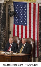 WASHINGTON, DC, USA -  FEBRUARY 2, 2005: Vice President Dick Cheney, left, and House Speaker Dennis Hastert, look on as President George W. Bush delivers his State of the Union speech before Congress.