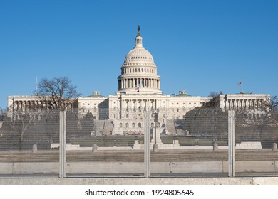 Washington, D.C., USA- February 24th, 2020: Tall barbed wire fencing surrounding the US Capitol building after January 6th.