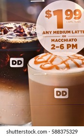 WASHINGTON DC, USA - FEBRUARY 26, 2017: A close up image of a Dunkin' Donuts advertisement billboard. Dunkin' Donuts is a fast food restaurant specializing in coffee and donuts.