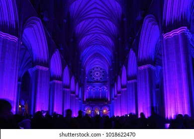 "WASHINGTON, DC / USA - FEBRUARY 5, 2018: The ""Seeing Deeper"" exhibit at Washington National Cathedral included lighting the interior of the Cathedral in various colors of light."