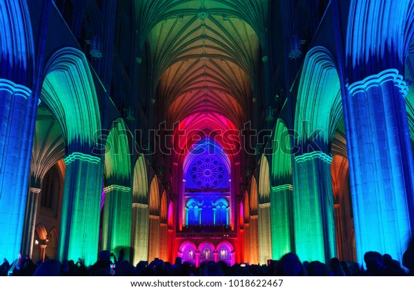 """WASHINGTON, DC / USA - FEBRUARY 5, 2018: The """"Seeing Deeper"""" exhibit at Washington National Cathedral included lighting the interior of the Cathedral in various colors of light."""