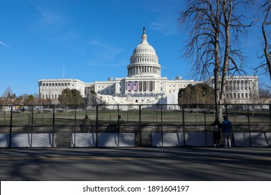 Washington, DC, USA - Jan. 10, 2020: A 7-foot tall security fence surrounds the U.S. Capitol building following the Capitol Hill riots on January 6.