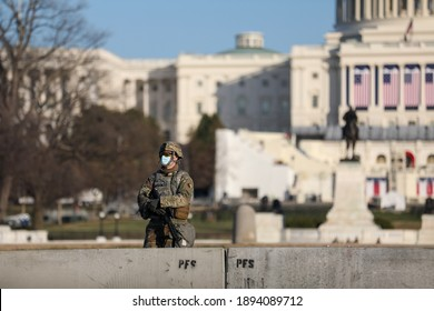 Washington, DC, USA - Jan. 14, 2021: Security is ramped up ahead of the inauguration of President-Elect Joe Biden. Fences are installed along the National Mall and the National Guard is brought in.