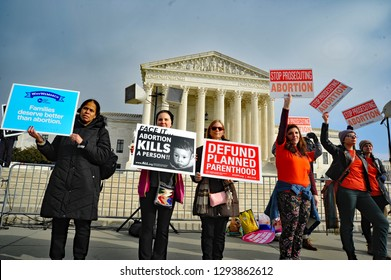 Washington DC / USA Jan 18, 2019: Pro-life supporters hold their ground in front of the U.S. Supreme Court with pro-choice protesters during the March For Life event in Washington DC