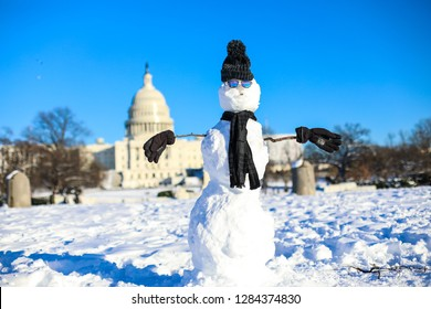 Washington, DC / USA - January 14, 2019: A snowman stands on the National Mall in front of the Capitol building after Winter Storm Gia dumps nearly a foot of snow onto the city.