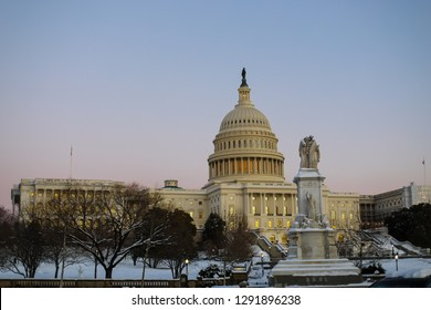 Washington, D.C. / USA - January 15, 2019: A view of the US Capitol building at sunset, including the House of Representatives and Senate, during a government shutdown on a cold winter day.