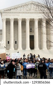 Washington, DC / USA - January 18, 2019: Pro life and pro choice protesters stand their ground in front of the U.S. Supreme Court over Roe V Wade in the nationals capital Washington DC.