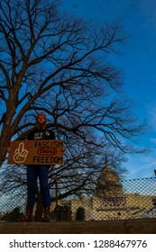 Washington, D.C. / USA - January 19, 2016: Anti-fascist/anti-trump protester in front of capitol
