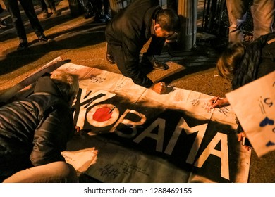 Washington, DC / USA - January 19, 2017: Obama Supporters Create a sign on the street during Obama's last days in office