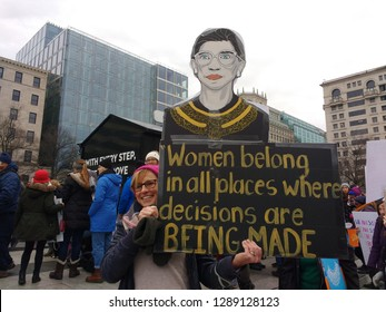 "Washington, D.C. / USA - January 19 2019: Women's March on Washington: A sign with the image of Ruth Bader Ginsburg with the words, ""Women belong in all places where decisions are BEING MADE""."